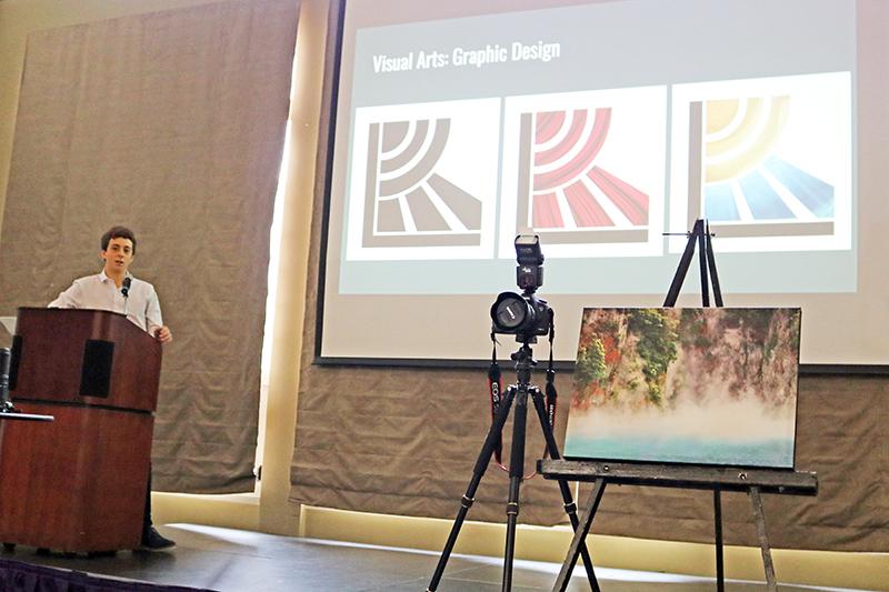 A Grauer senior presenting his senior portfolio